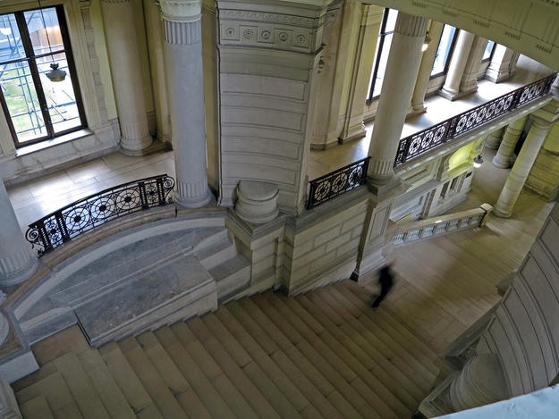 A monumental staircase passes by one of the eight courtyards in the Brussels Palace of Justice, much of which is unoccupied, 2015