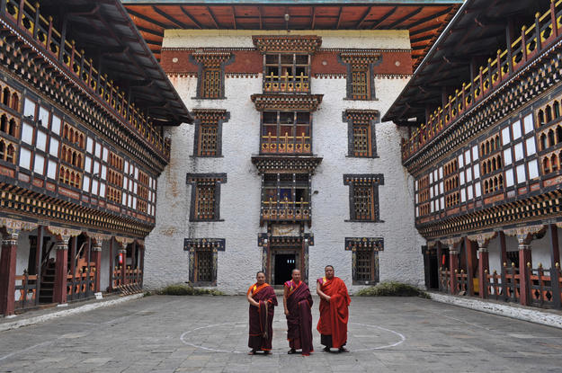 Some resident monks pose in the courtyard, 2010