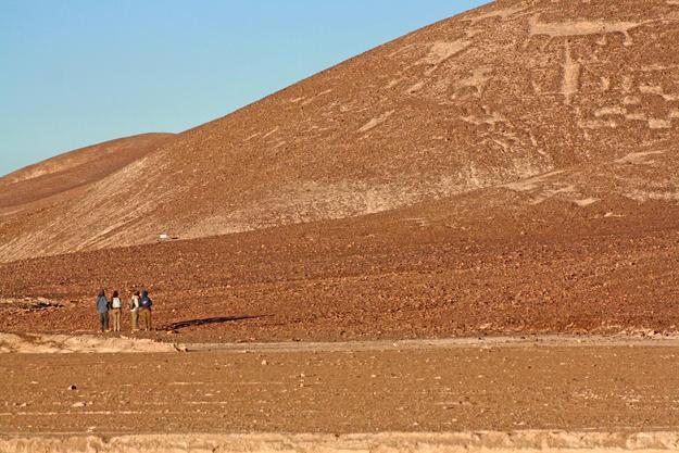 Visitors observe a section of the Chug-Chug Geoglyphs, 2010