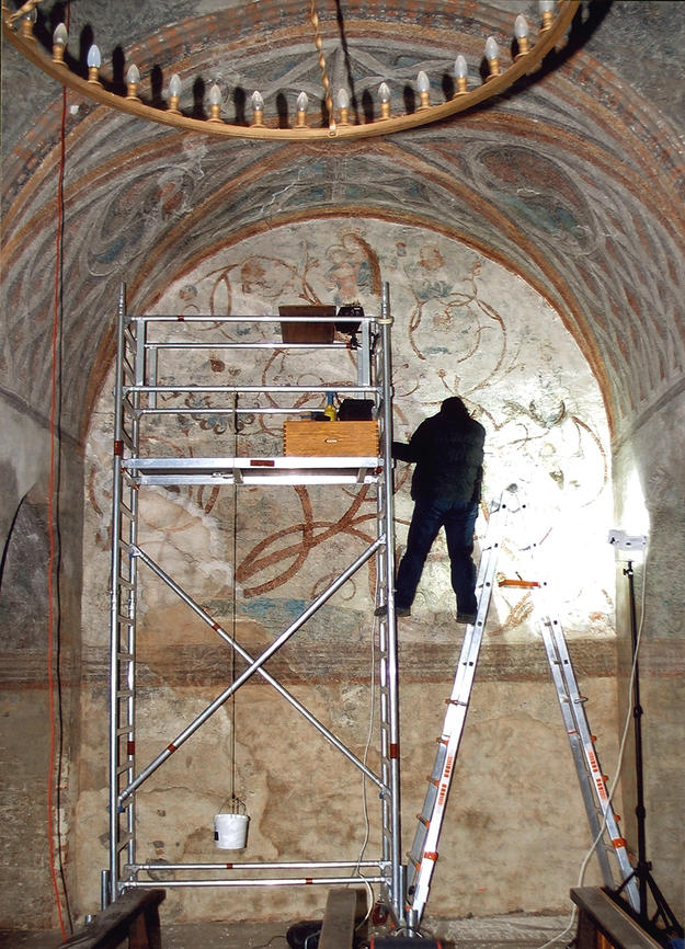 Conservator working on the wall murals, 2004