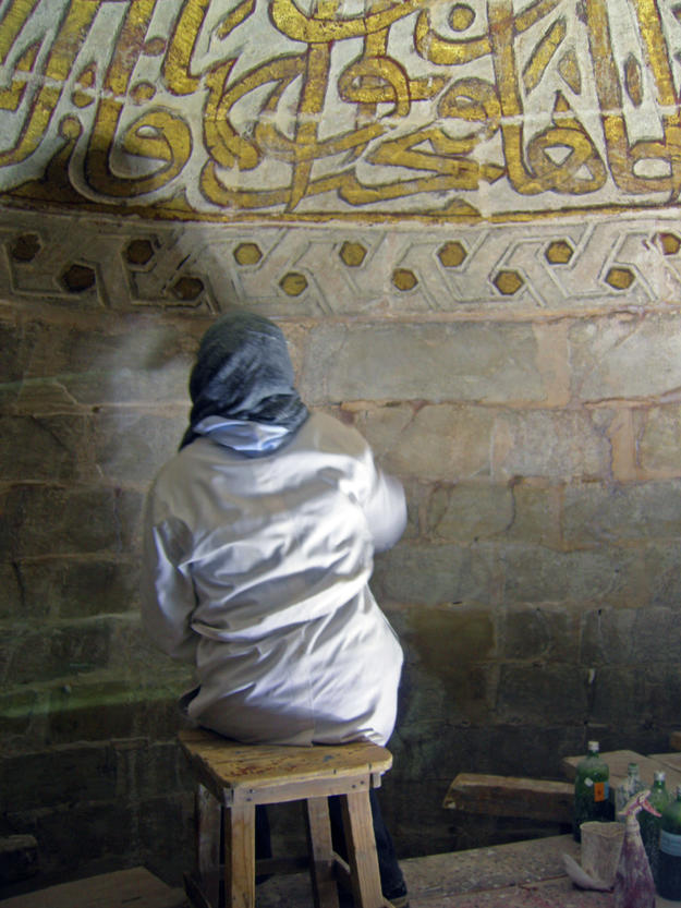 Conservator at work in the Khayrbek Complex, 2006