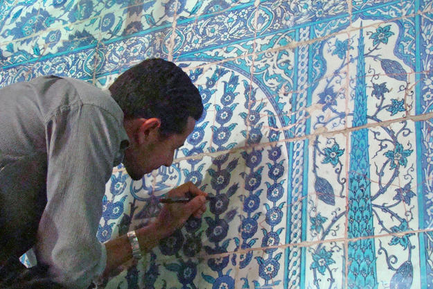 Conservator working on the southeast interior wall, 2011
