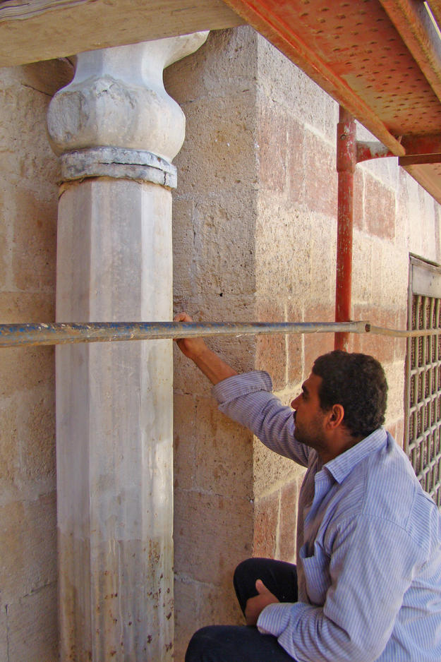 Conservator working on the southwest interior wall , 2011
