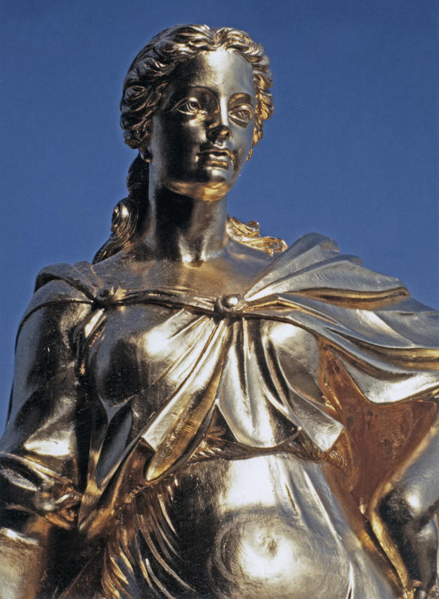 One of the new gilded statues on the dome's lantern, 1994