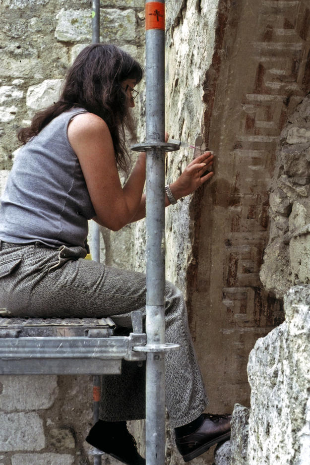 Conservator stabilizing the west wall of the nave , 2003