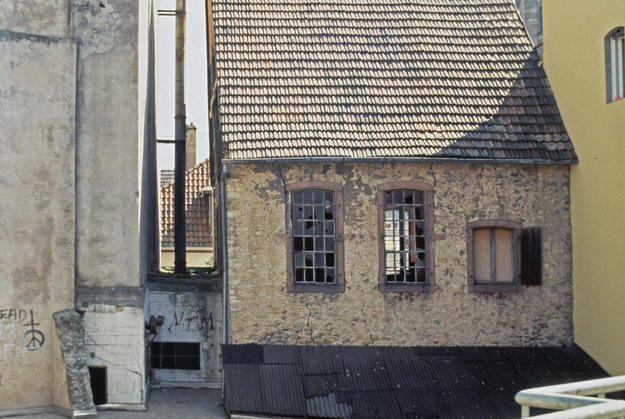 Façade with a steep pitched tiled roof , 1995