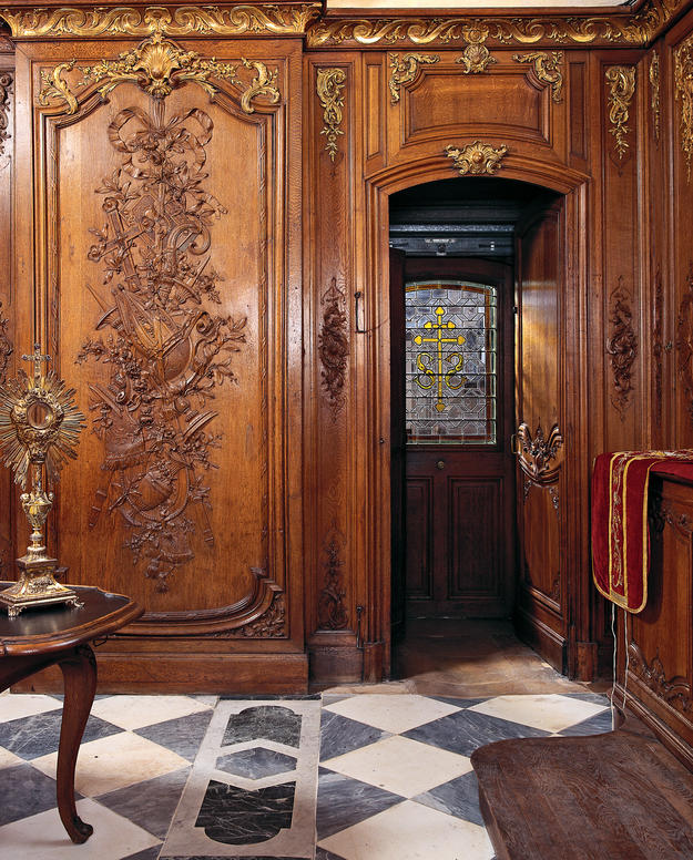 Intricate wood paneling of the sacristy , 2003