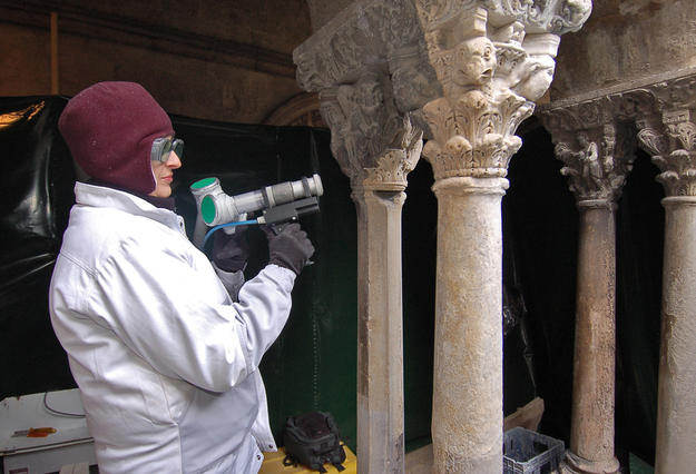 Conservator cleaning a capital, 2008