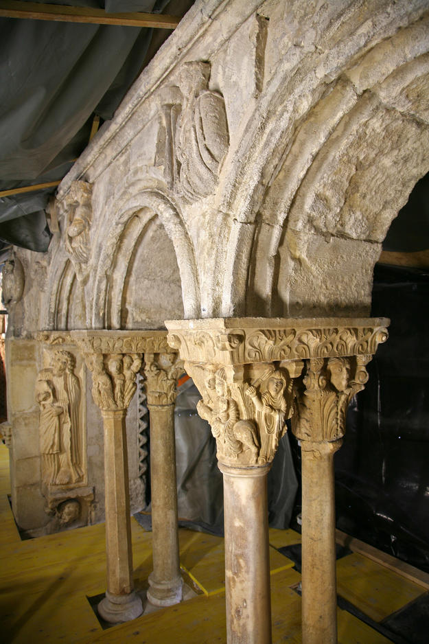 The east gallery with Romanesque bas-relief sculptures and carved capitals , 2013