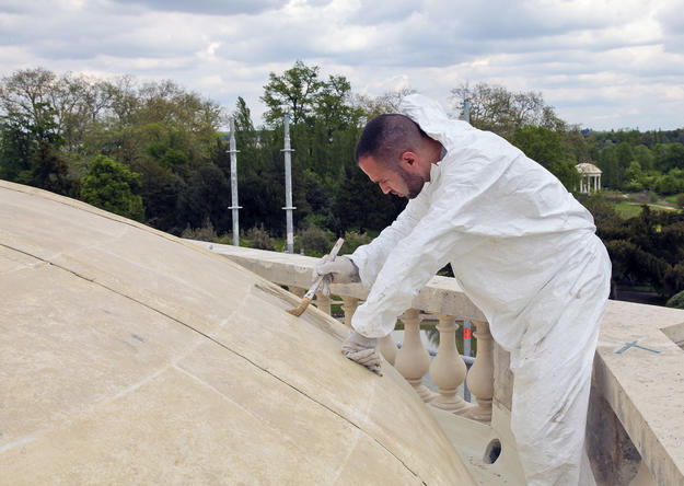 A conservator repairs the roof, 2012