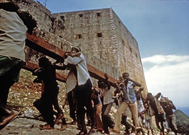 Local workmen hauled wooden beams, often weighing over a ton, up the peak to the fortress, 1987