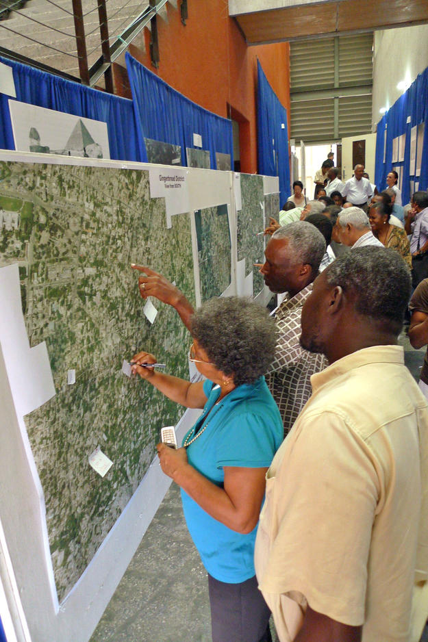 Homeowners mark their houses on a map at a community meeting, 2010