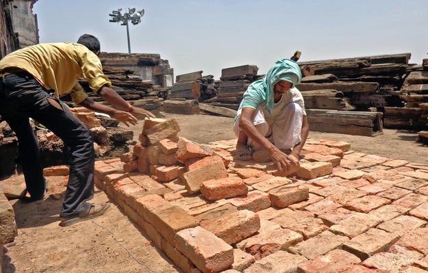 Creating a brick platform at the site, 2013