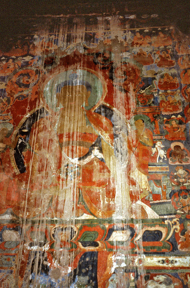 A damaged mural of the Buddha , 2002
