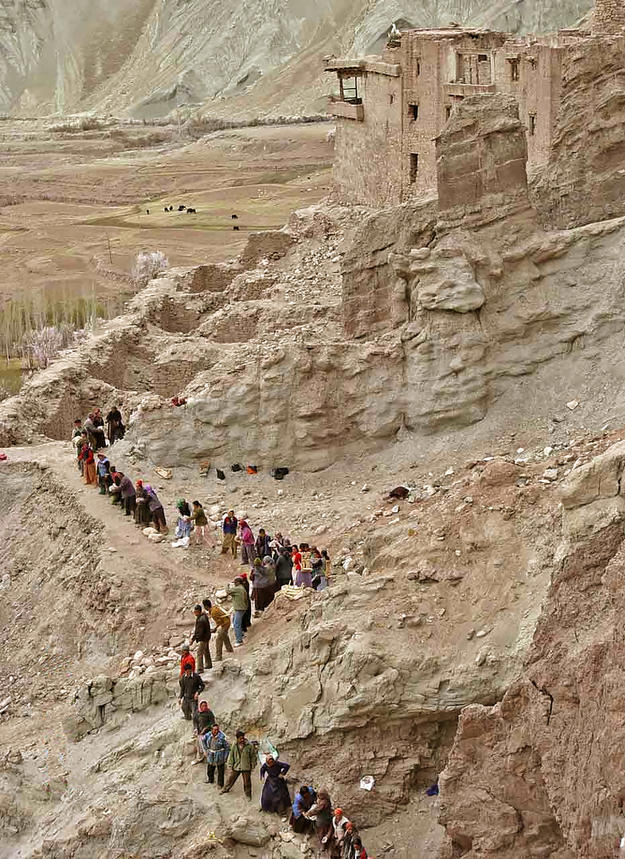 Villagers carry stone to the Serzang temple for the construction of the retaining wall, 2004