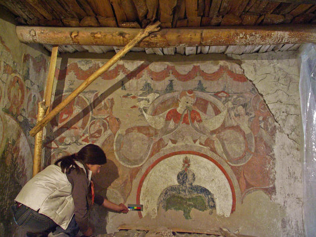 Conservator working on a mural in the Red Maitreya Temple, 2006