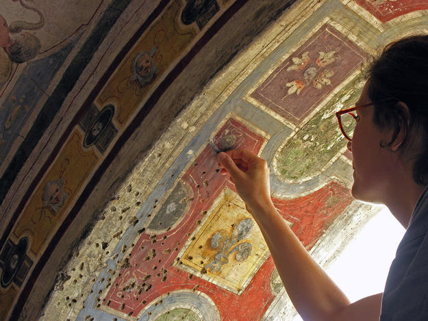 Conservator at work on arch painting, 2012