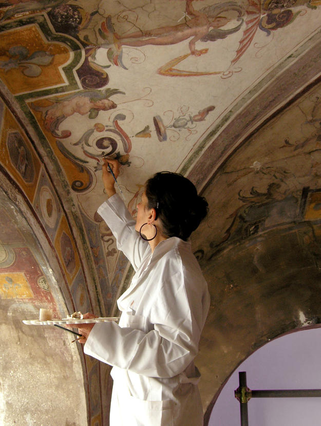 Conservator working on decorative painting, 2012
