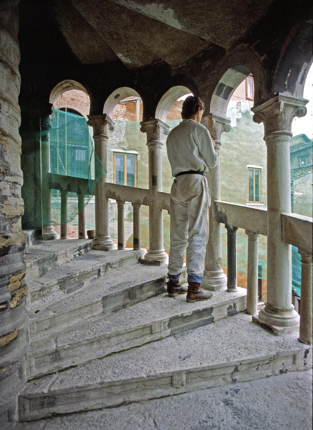 A conservator stands on the reconsolidated steps, 1981