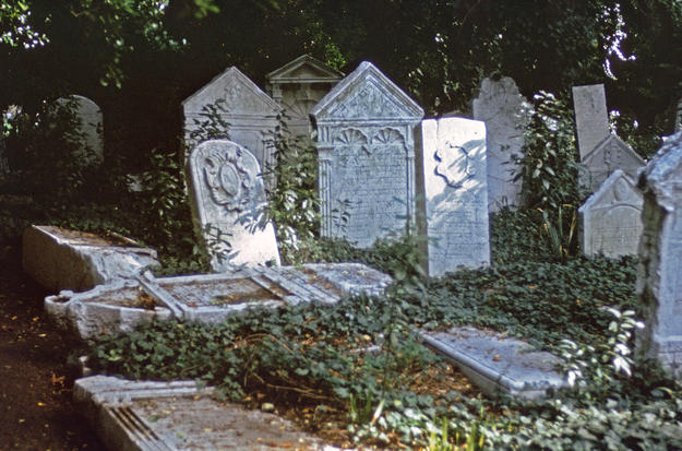 Scattered and broken tombstones, 1975