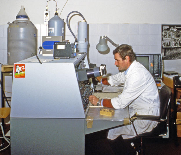 A researcher works to develop effective conservation treatments, 1982