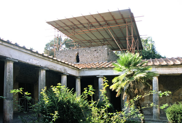 Peristyle and roof surrounding interior courtyard of the House of the Silver Wedding Anniversary during conservation , 1999