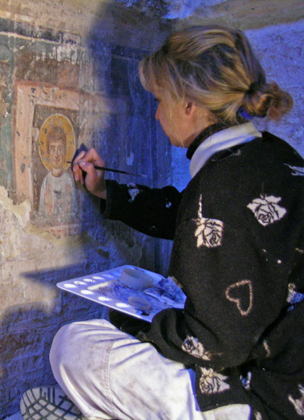 A conservator works on a wall painting , 2007