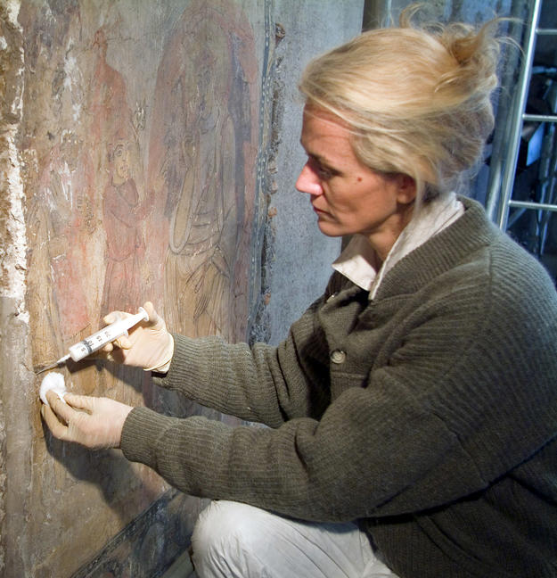 A conservator preserving a medieval fresco, Feb-07