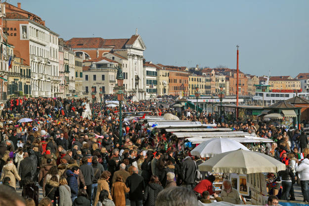 Mass tourism impacts the historic city, 2009