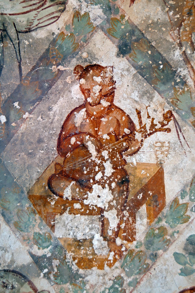 Detail of a bear playing a lute in the southern wall of the frigidarium, 2009