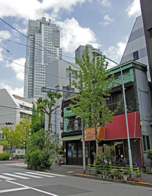 The Yuasa merchant house shown amid growing new development in Tsukiji, 2015