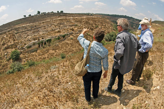 Conservators look towards the site from the opposite side of Wadi bel Ghadir, 2013