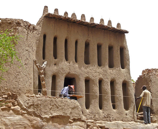 Conservators surveying the Arou Temple , 2009