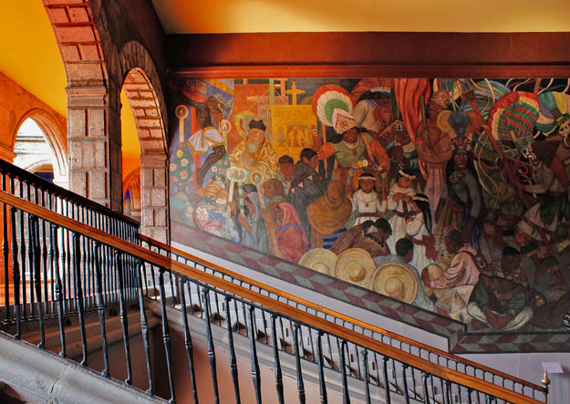 Murals adorn the wall of a staircase on the second floor of the Antiguo Colegio de San Ildefonso, 2015