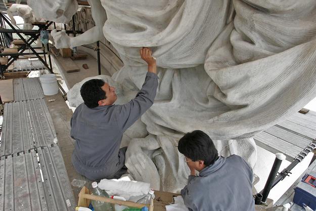 Conservators work on the Art Deco decorative elements, 2004
