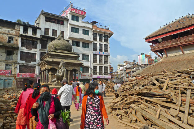 Rubble in the Kathmandu Durbar Square with the small Bimaleshwar Temple and the kneeling sculpture of Garud, 2015