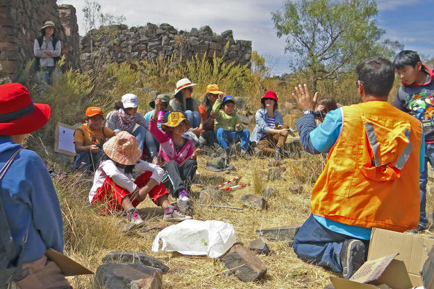 Schoolchildren from the nearby town of Andahuaylillas participate in an archaeological workshop at Rumiqolqa, 2013