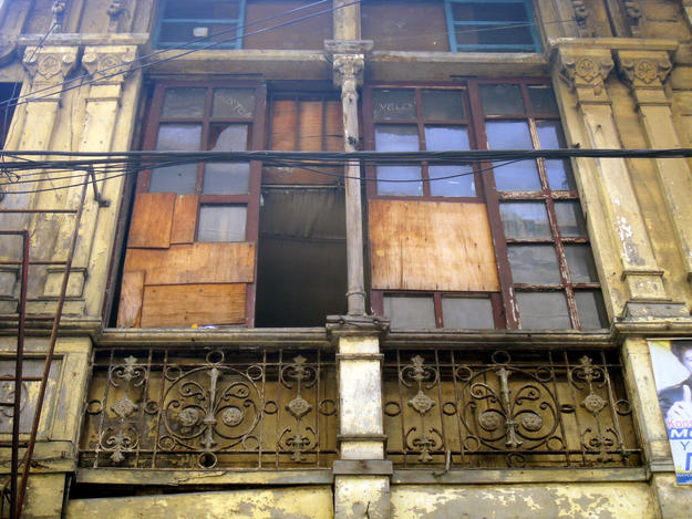 The Boix House features decorative pilasters, colonettes, and wrought iron grills, all in need of restoration, 2013