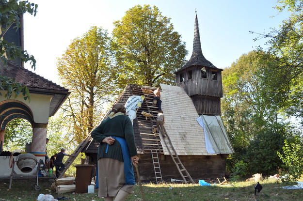 A villager watches the repairs of the roof of the church of Tarnavita, 2012