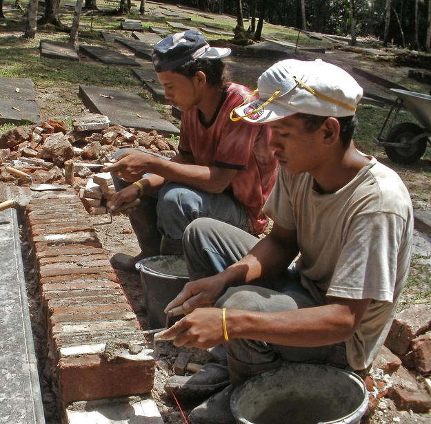 Local residents, trained in conservation, fix graves 82 and 83, 2011