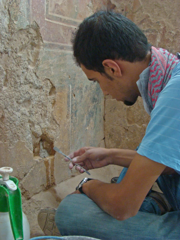 A conservator cleans and consolidates the Roman wall paintings, 2010