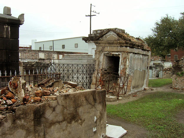 Open tomb in background with deteriorated tomb in foreground, March 2009