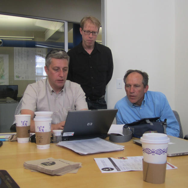 Members of the project team review the program's development at Farallon Geographics in San Francisco, 2012