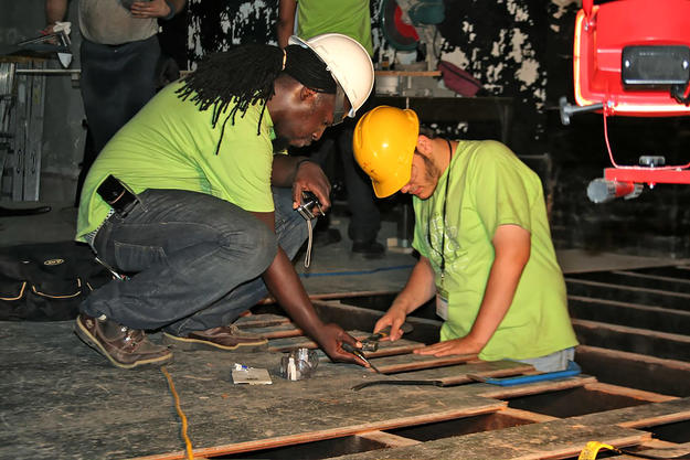A field program student learns how to repair the stage floorboards, 2009