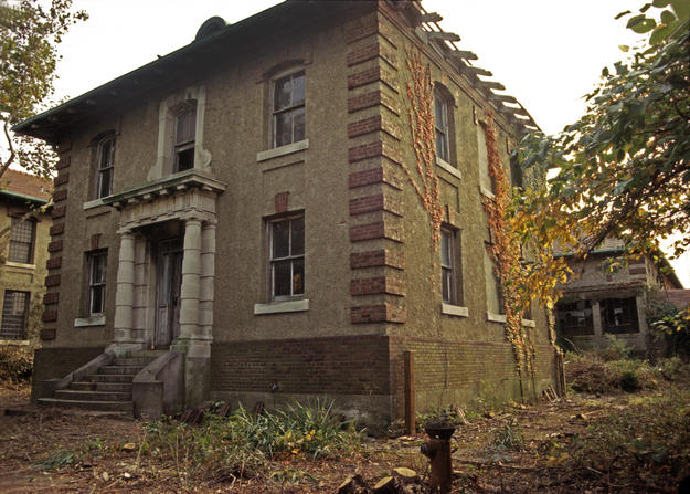 West side of the Office building after clearing and before conservation, 1997