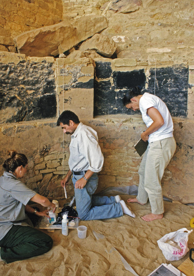 Conservators working on Kiva K in the Cliff Palace, 1998
