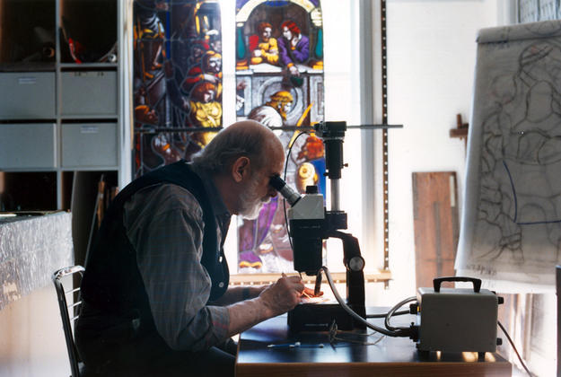 Master glass conservator Melville Greenland preparing a sample for photo documentation, 1990