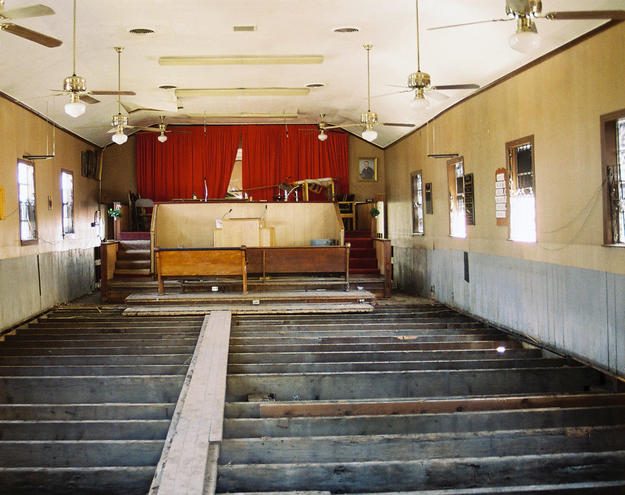 Interior, with its wooden floor and pews lost, before conservation, 2006