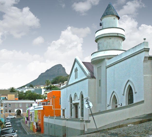 A view of Mosque Shafie, one of many mosques in Bo-Kaap, with the peak of Cape Town's Lion's Head mountain in the background, 2014