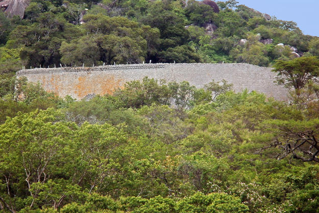 The uncontrolled growth of vegetation has been a long-standing threat to the preservation of Great Zimbabwe, 2015